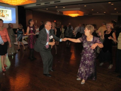 On the Dance Floor: Stan Cracovia and Rita Naclerio being cheered on by Joan Drexel